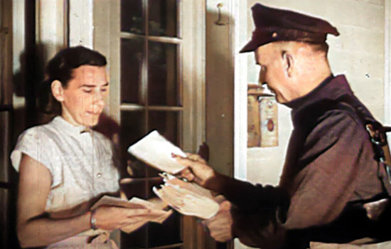 1940 Mailman hand-deliviering mail to housewife at her door